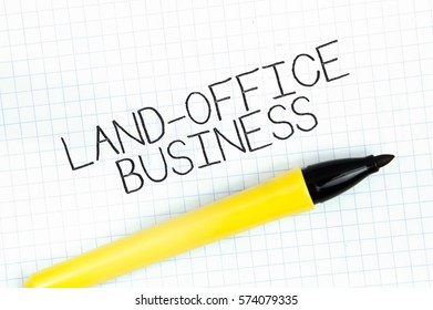 LAND-OFFICE BUSINESS concept write text on notebook