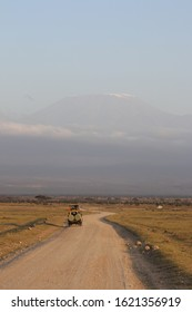 Landrover driving off with Mt. Kilimanjaro in the background