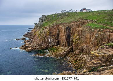 Land's End, UK – May 30 2017 : A White hotel near a rocky cliff on Land's End on a cloudy day.