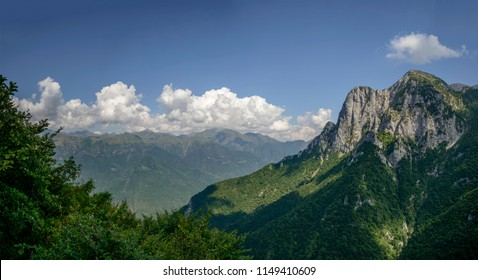 landsacpe of steep rock cliffs on northern side of Grigna peak, shot in bright summer light from near Cainallo Alp, Lecco, Lombardy, Italy
