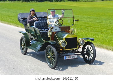 LANDSBERG, GERMANY - JULY 12: Oldtimer rallye for at least 80 years old antique cars with Ford T Touring, built at year 1910, photo taken on July 12, 2013 in Landsberg, Germany