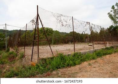 Landscape. Abandoned en neglected tenniscourt in France