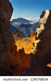 Landscape above the crater Caldera de Taburiente with a man sitting on the rock, Island of La Palma, Canary Islands, Spain