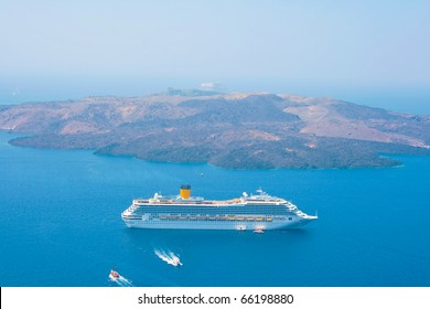 Landscape of Aegean sea with big passenger cruise ship near volcano on island of Santorini, Greece. Caldera view.