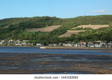 Landscape along the Saguenay River near Petit Saguenay Quebec including agricultural clearings