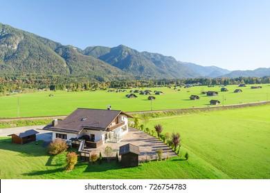 Landscape of Alpine pasture land in valley at foothills of Bavarian Alps