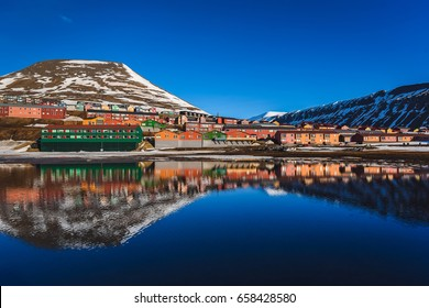 landscape of the Arctic Ocean and reflection with blue sky and winter mountains with snow  , Norway, Spitsbergen, Longyearbyen, Svalbard