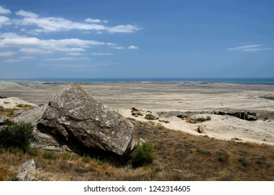 Landscape around Gobustan Natural park with beautiful stones and Caspian Sea, famous for its ancient neolithic rock paintings, mud volcanoes and gas-stones in the region,Azerbaijan