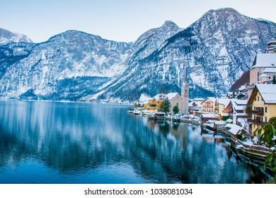 Landscape around the Hallstatt Town. Beautiful view of traditional wooden houses in famous Hallstatt lakeside town in the Alps on a beautiful day in winter, Salzkammergut region, Austria.  Europe