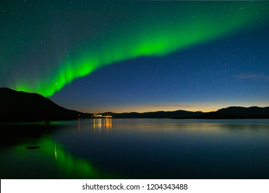 Landscape with Aurora borealis and Tornetrask lake. Northern Sweden