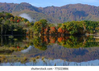 Landscape of autumn lake in the forest, reflecting autumn leaves and mountain on the water, Yanohara-shitsugen, Showa-village, Fukushima, Japan