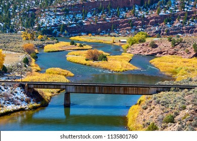 Landscape with autumn trees and river. Rocky Mountains, Colorado, USA.