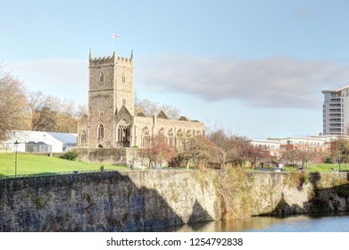 A landscape of the Avon river in front of the rumbled Saint Peter's Church in the Castle Park from the Bristol Bridge in the Bristol, United Kingdom