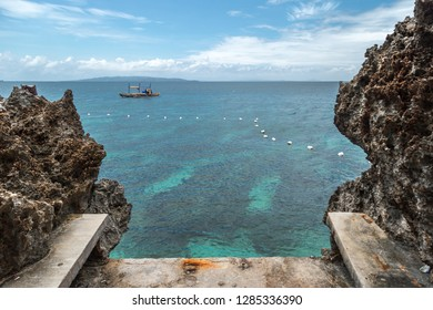 Landscape azure sea and a rocky coast Crystal Cove small island near Boracay island in the Philippines