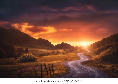 landscape background with path in Urkiola at sunset