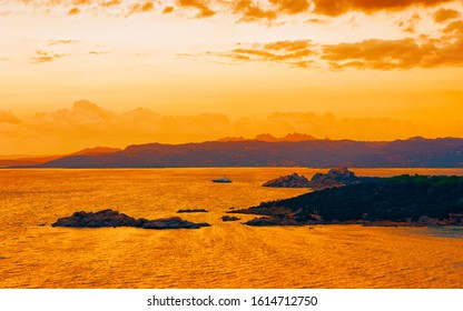Landscape at Baja Sardinia luxury resort, Costa Smeralda at sunset and evening, Sardegna island in Italy in summer. Scenery in Olbia province. Sunset at Mediteranean sea. Mixed media.