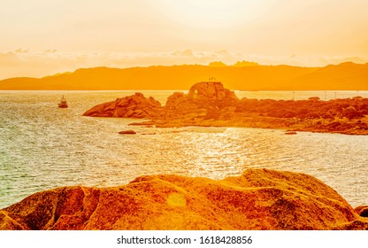 Landscape at Baja Sardinia luxury resort, Costa Smeralda at sunset and evening, Sardegna island in Italy in summer. Scenery in Olbia province. Sunset at Mediteranean sea