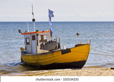 Landscape with Baltic Sea. Fishing boat on the beach.