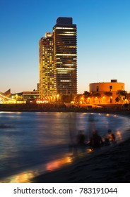 Landscape of Barceloneta Beach in summer evening in Barcelona, Spain