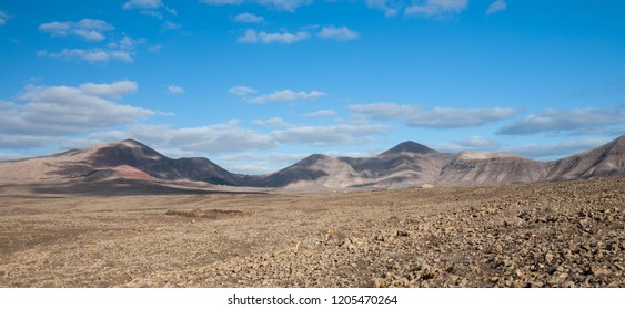 A landscape of barren volcanic wastelands in the southern part of Lanzarote, one of the Spanish Canary Islands