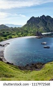 Landscape bay view from Padar island in Komodo islands, Flores, Indonesia. A tourist boat on the water.