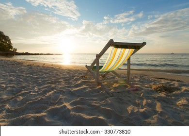 Landscape of Beach chair and beautiful sunrise in the morning.