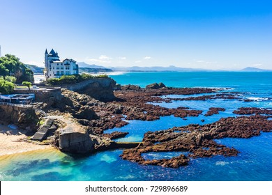 Landscape of a beach in the city of Biarritz at low tide with the Basque Coast in the background, France.