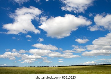 Landscape with a beautiful blue cloudy sky