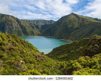 Landscape with beautiful blue crater lake Lagoa do Fogo from viewpoint Miradouro da Lagoa do Fogo. Lake of Fire is the highest lake of Sao Miguel island, surrounded by Natural Reserve green forest
