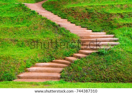 Landscape Of Beautiful Brown Color Stair Up To The Hill With Grass Field  Beside The Walkway