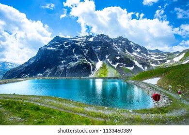 landscape of beautiful lake and cloudy sky with summer alps mountain view in Austria.