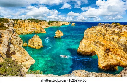 Landscape with beautiful Praia da Marinha, one of the most famous beaches of Portugal, located on the Atlantic coast in Lagoa, Algarve.