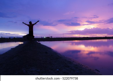 Landscape beautiful sky and silhouette of man standing  at sunset  / soft focus