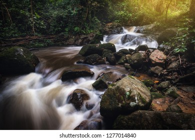 Landscape of beautiful waterfall in the evergreen jungle forest in Thailand., Natural scenery background.