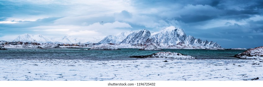 Landscape with beautiful winter sea and snowy mountains at Lofoten Islands in Northern Norway. Panoramic view