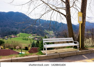 Landscape with bench at valley in Celje old town in Slovenia. Architecture at the green hill in Slovenija. Alps mountains on the background.