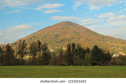 landscape of Beskydy mountains with colorful trees on the hills in autumn, Czech Republic