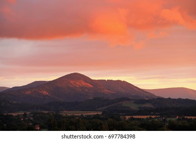 landscape of Beskydy mountains in the evening light with colorful sky and clouds