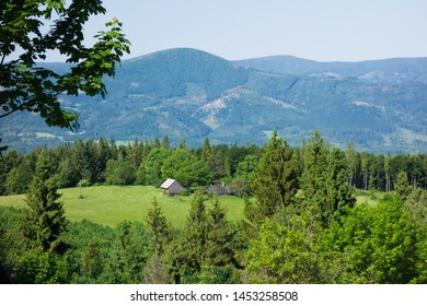 Landscape in the Beskydy mountains with old wooden houses. Moravian Silesian region, Beskydy, Czech republic, Europe. Summer day.