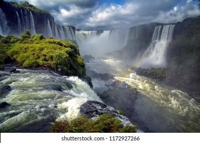 Landscape of big beautiful waterfalls with rainbow, Cataratas do Iguacu (Iguazu Falls), Foz do Iguacu, Parana State, South Brazil