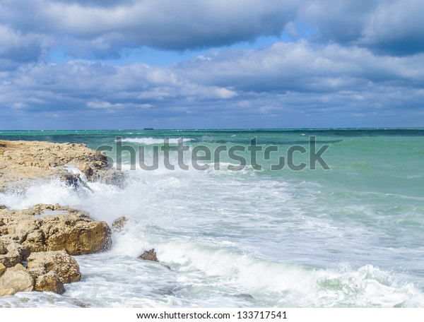 Landscape of the Black sea water crashes over the rock