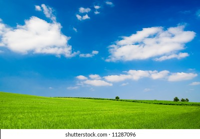 Landscape with blue cloudy sky (ideal for background or wallpaper)