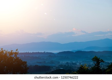 Landscape of blue sky and mountain in blue gradient view with the sun rise in the morning