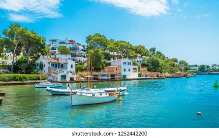 Landscape with boat and Cala D'or village, Palma Mallorca Island, Spain