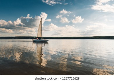 landscape. boat with a sail on the lake