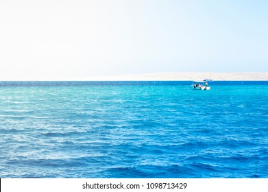 Landscape with boat, sea, bright sun and blue sky