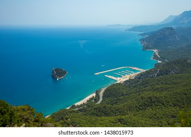 Landscape with boats and sea in marina bay. Top view aerial horizontal color photography of harbor with yachts, motorboats and sailboats. Tunektepe, Antalya, Turkey