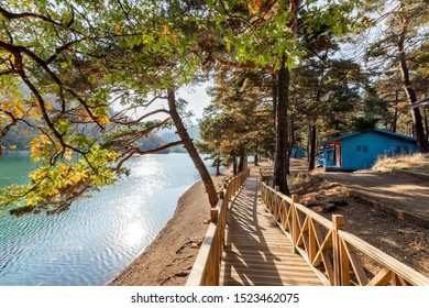 Landscape of Boraboy, Borabay or Kocabey lake with wooden walkway and a house in Tasova, Amasya, Turkey. The nature park offers outdoor recreational activities such as hiking, motocross, off-roading,