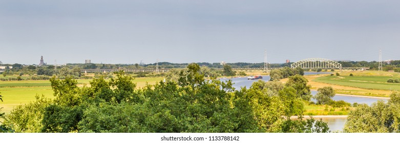 Landscape with a bridge over the Rhine near Arnhem in the Netherlands