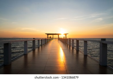 Landscape of bridge in sea on tropical beach and sunset sky background .